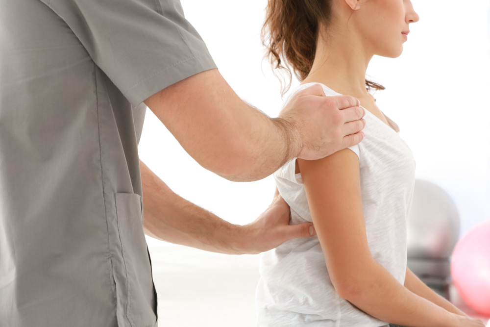 Woman getting Chiropractic Adjustment